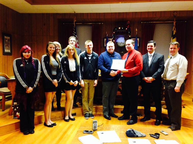 Members of the Allegany High School Color Guard Accept a Certificate of Recognition From the Mayor a