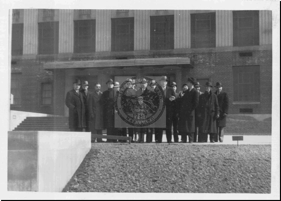 Group of Men in Front of Fort Hill High School