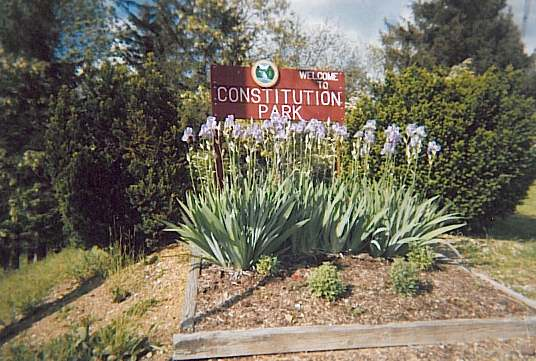 Flowers in Front of the Constitution Park Sign