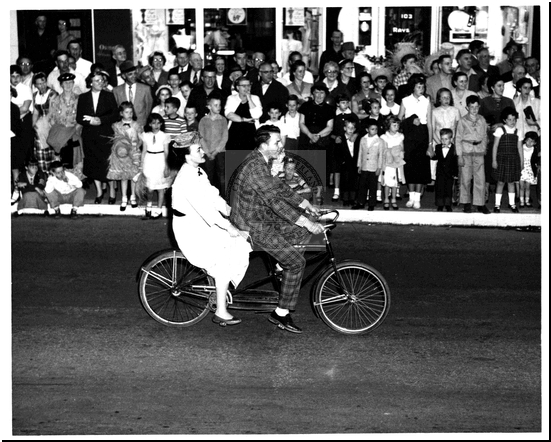 Riding a Bicycle in a Parade