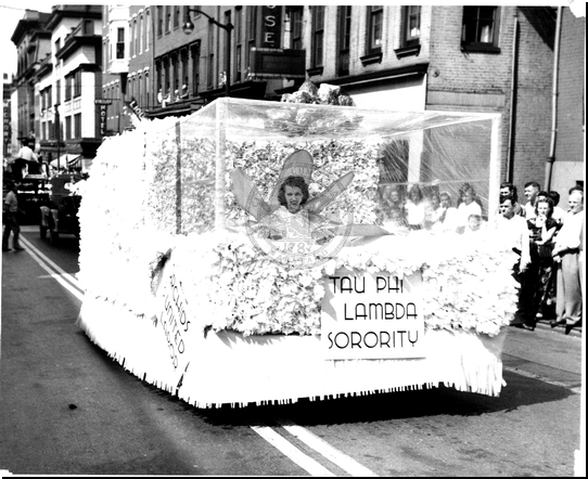 Tau Phi Lambda Sorority Float in a Parade