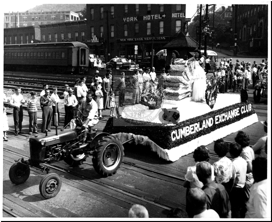 Tractor Pulls a Float in the Parade on Baltimore Street