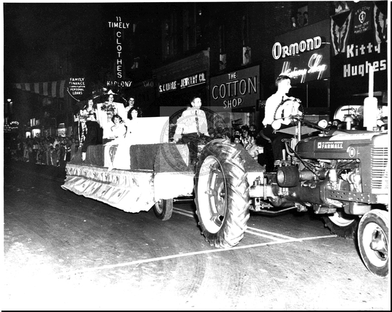 Tractor Pulls a Float Through the Parade on Baltimore Street
