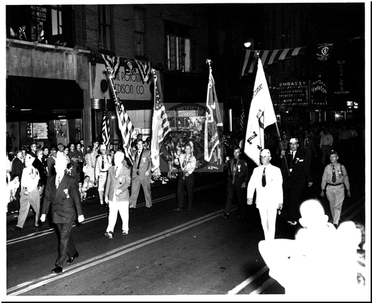 Marching With Flags in the Parade on Baltimore Street