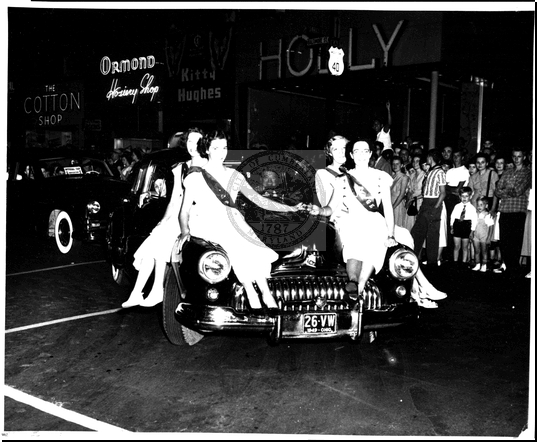 Cars, Girls, and Spectators in the Parade on Baltimore Street
